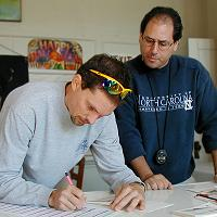 Terry Leckie and Patrick Farris working on the results of the 2003 Greasy-Gooney 10K
